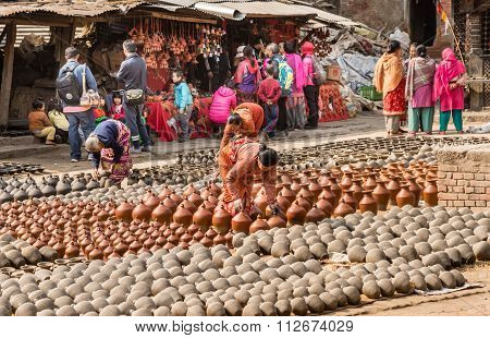 Woman Checking Pots Bhaktapur.