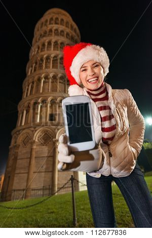 Woman In Santa Hat Showing Mobile Phone Near Leaning Tower, Pisa
