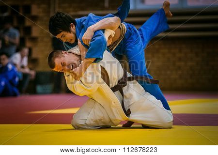 final match between two young athletes judoists