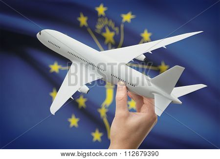 Airplane In Hand With Us State Flag On Background - Indiana