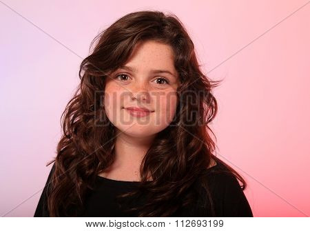 Beautiful young brunette girl in studio