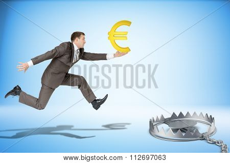 Businessman running forward with euro sign