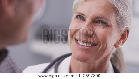 Medical doctor talking with male patient