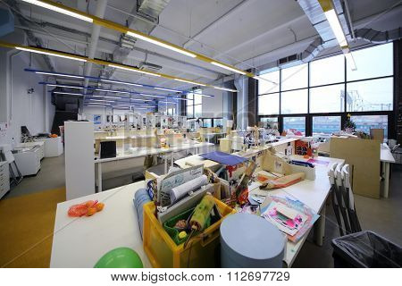 RUSSIA, MOSCOW -?? 07 DEC, 2014: Light office with many workplaces near railway station at British Higher School of Art and Design.