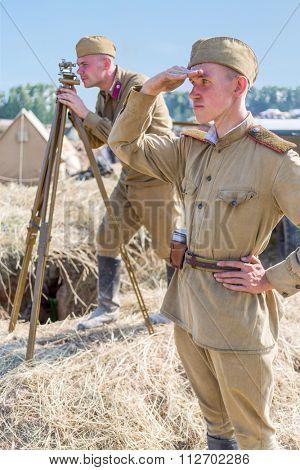 NELIDOVO, RUSSIA- JULY 12, 2014: Battlefield 2014: Two Soviet soldiers observe the battlefield