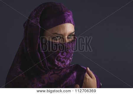 Beautiful arabic woman with traditional burqa veil