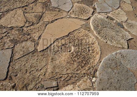 Broken millstones
