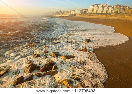 Peaceful ocean surf on the beach of Porto, Portugal.