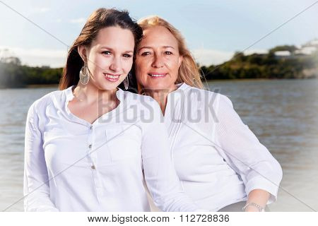 Mother And Daughter Posing In The Summer Sun