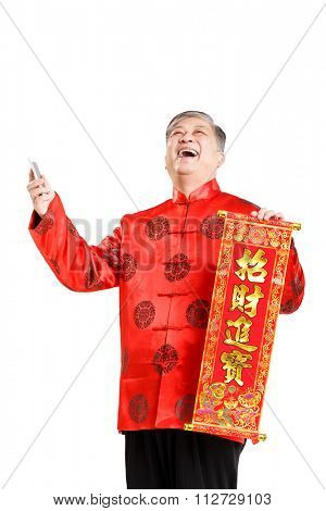 portrait gesture of old Chinese man with mandarin(Chinese words on couplet means good luck)