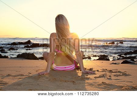 Blonde Lady Facing The Sun On The Beach
