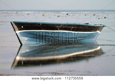 Traditional Fishing Boat With Reflection On The Water