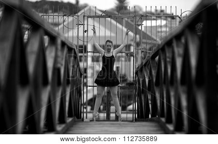 Ballerina In Front Of Gate