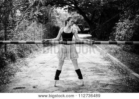 Ballerina Holding Boom Gate