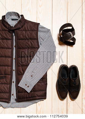 Autumn casual outfit for men. set of warm brown vests light shirt leather shoes and belt. photo on the wooden background poster