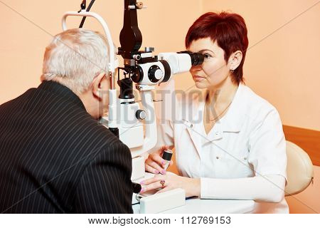 Optometry concept. female optometrist optician doctor examines eyesight of female patient in eye ophthalmological clinic
