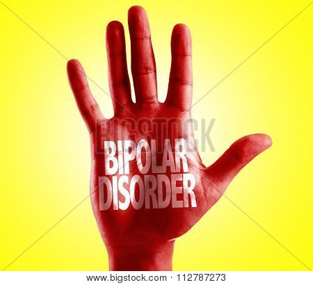 Bipolar Disorder written on hand with yellow background poster