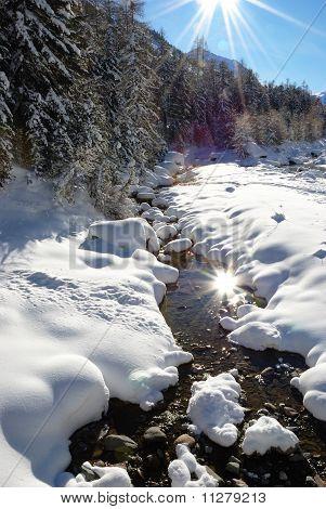Sun mirroring on mountain stream