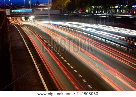 Streaks of coloured light from vehicles
