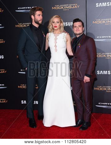 LOS ANGELES - NOV 16:  Liam Hemsworth, Jennifer Lawrence & Josh Hutchinson at
