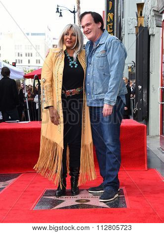 LOS ANGELES - DEC 21:  Quentin Tarantino & Pam Grier arrives to the Walk of Fame honors Quentin Tarantino  on December 21, 2015 in Hollywood, CA.