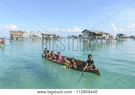 Borneo Sea Gypsy kids on a canoes