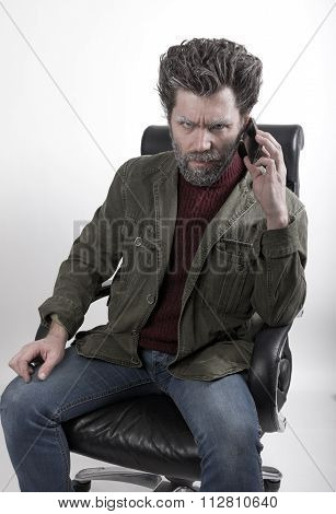 Mr.  IceMan talking on the phone. fashion man in a knitted sweater and jacket.