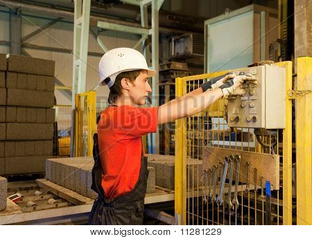 Factory worker fixing broken device