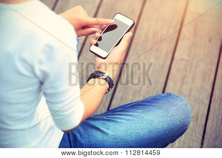 closeup of one young woman use smartphone outdoor