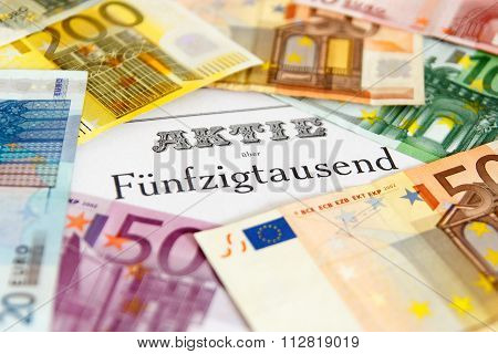 Share outlined with Euro banknotes and depth of focus