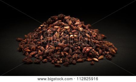 Pile of Organic Dried Pomegranate seeds (Punica granatum) on dark background. poster