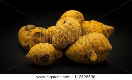 Pile of Organic Round Turmeric (Curcuma longa)