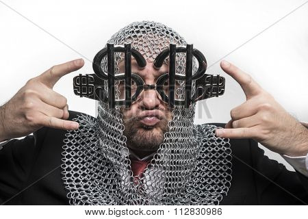 financial, businessman with medieval executioner in metal and silver glasses. concept of protection of savings and money