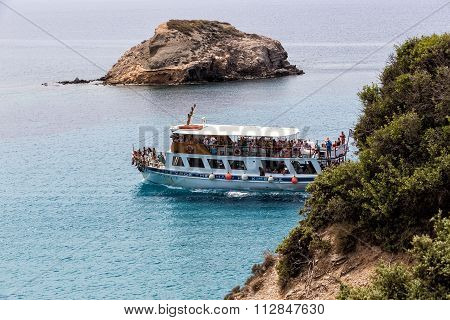 Snow-white Yacht In The Blue Waters Of The Picturesque Bay In Milos Island, Cyclades, Greece