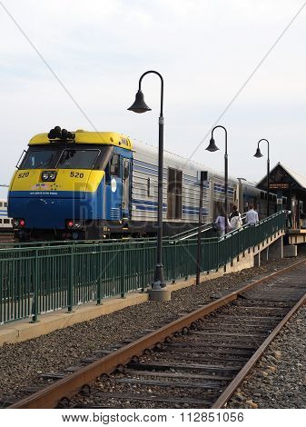 MONTAUK, NEW YORK-JULY 14: A commuter railroad train is seen with tourists in station at beach town of Montauk, New York, USA on July 14, 2016.