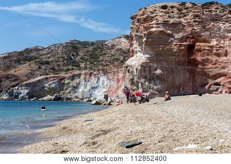 Tourists Enjoy The Clear Water Of The Beautiful Beach In Milos Island, Cyclades, Greece