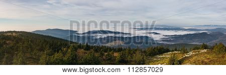 View From The Autumn Mountains Into The Valley With Low Clouds