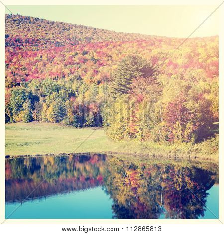 Stunning fall foliage and lake in Vermont, USA, with Instagram effect filter