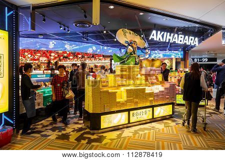 TOKYO JAPAN - NOVEMBER 29 2015: People shops at a duty free shop provided for the departure at Narita international airport