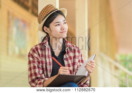 Woman is composing poems