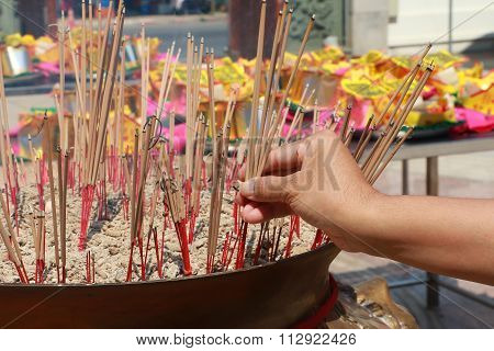 Burning incense in Chinese temple