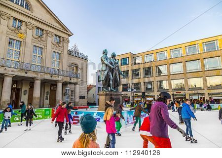 People In Front Of Goethe And Schiller Monument Enjoy Ice Skating
