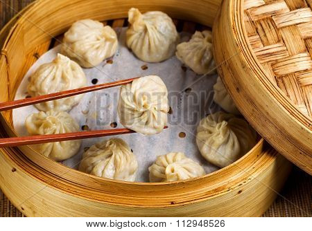 Freshly Steamed Chinese Dumplings Out Of Bamboo Steamer Ready To Eat