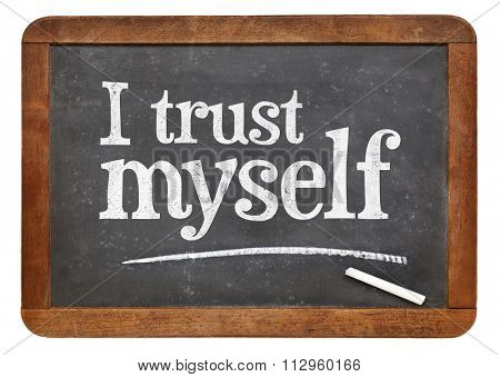 I trust myself - self confidence or positive affirmation concept - white chalk text on a vintage slate blackboard