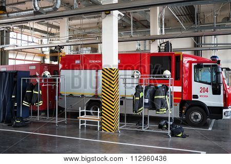 RUSSIA, MOSCOW - MAY 29, 2015: Garage with fire truck, uniform and fire-fighting equipment.