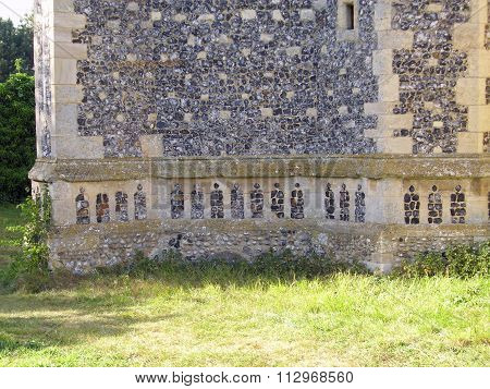 Ornamental flint in church wall