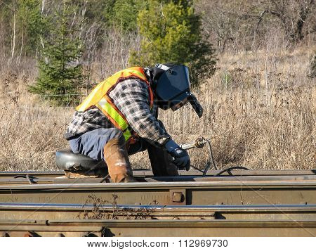 Welder Working On A Rail