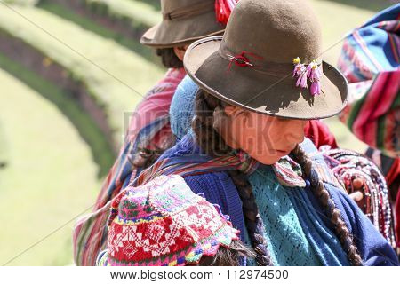 PISAC, PERU - MARCH 5, 2006: Unidentified people at Inca citadel in Sacred Valleyl near Pisac in Peru. Sacred Valley of the Incas is a valley in the Southern Sierra that contains many famous and beautiful Inca ruins