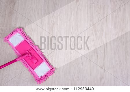 Cleaning Concept -pink Wet Mop Cleaning Wooden Floor