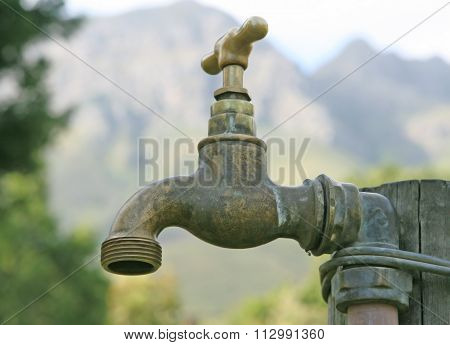 Old Garden Tap With Outdoors In Summer